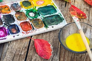 Paint on the autumn table