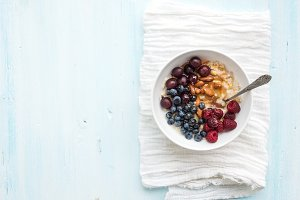 Bowl of oat porridge with berries