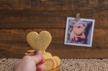 Hand holding a cookie, and photo