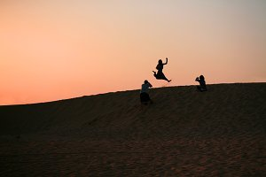 Girl jumps in the desert