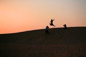 Girl jumps in the desert