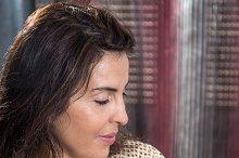 Portrait of beautiful woman listenin
