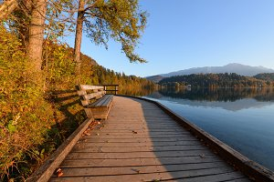 Wooden pier at lake Bled at sunrise