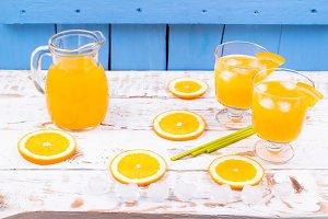 Segment of orange and juice