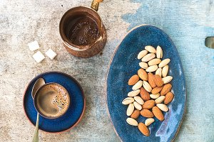 Black coffee with almonds