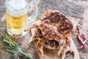 Grilled quails with glass of beer