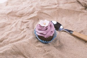 Strawberry cupcake and spoon