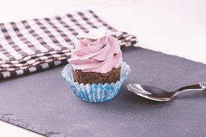 Cupcake, spoon on slate base