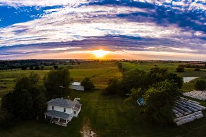 Sunset over farmhouse