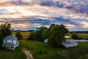 Farmhouse panoramic sunset