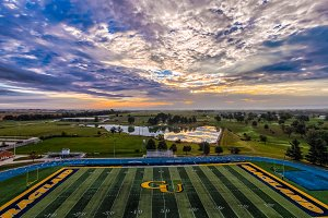 Sunrise over football field