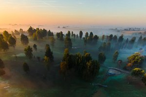 Aerial view of foggy sunrise