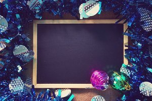 blackboard with christmas ornament