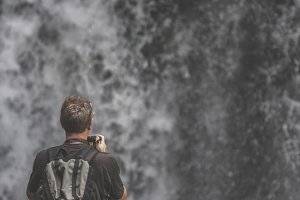 Man and waterfall