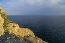 Steep seacoast lit by evening sun