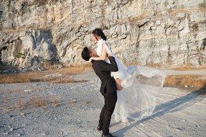 groom carries the bride