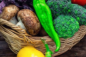 wicker basket with fresh vegetables