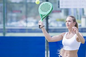 girl playing paddle tennis match
