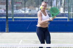 girl playing paddle tennis