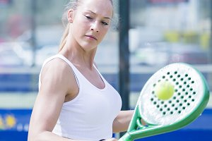 woman playing paddle tennis outdoors