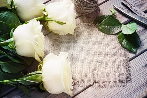 White Roses on the Wooden Table
