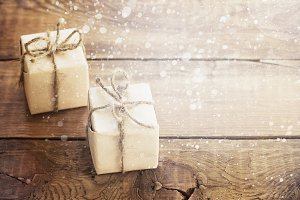 Christmas presents on dark wooden background in vintage style