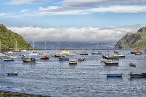 Portree harbour with boats on Skye