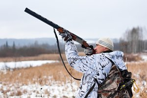 hunter shooting on the snowy field