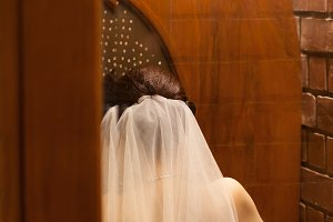 bride was confessional in the church