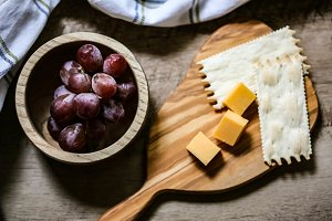 Rustic Table with Cheese & Grapes