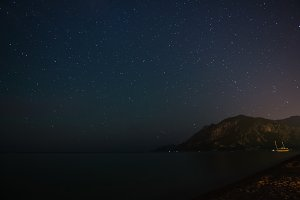 Starry sky at night at the sea coast