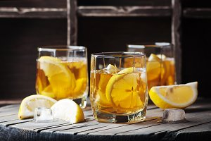 Cold whiskey with ice and lemon