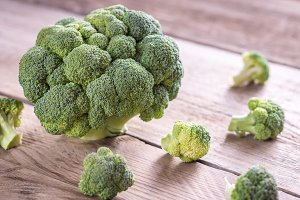 Fresh broccoli on the wooden board