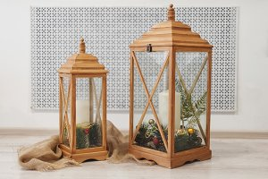 Wooden lantern and christmas decoration on white background