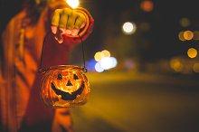 Little Girl Holding Halloween Candle