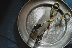 Plate and vintage cake tongs