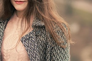 young beautiful woman in autumn coat