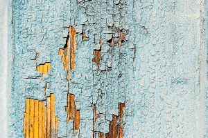 Peeling paint on weathered wood