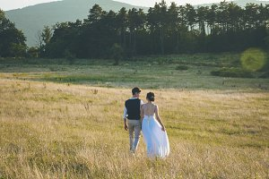 Couple walks on the meadow