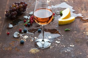 Glass of rose wine with berries