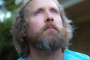 Man- Blue Eyes & Beard Gazing at Sky