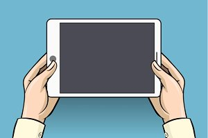 Hands holding tablet computer