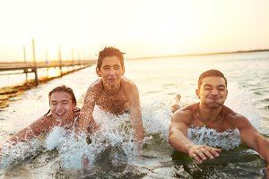 Boys splashing in the water