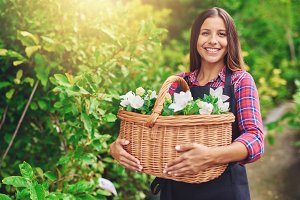 Woman with flowers in a basket