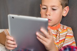 The boy using tablet