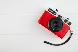 Cute red camera on white background