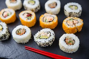 Sushi with red chopsticks