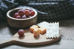 Rustic Cheese and Grapes on Table
