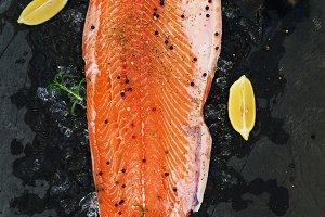 Raw salmon filet with lemon