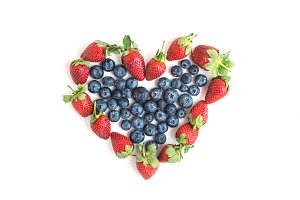 Heart sign made of fresh blueberries
